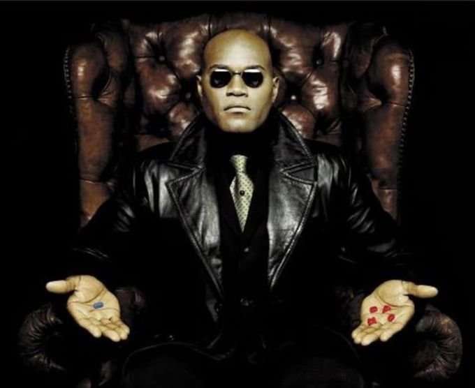 Morpheus from The Matrix, holding a blue pill in his right, opened hand and red pills in his left, opened hand